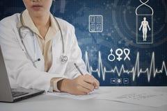 Doctor writes prescription on the desk Stock Photos