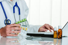 Doctor writes a prescription for tablets stock photos