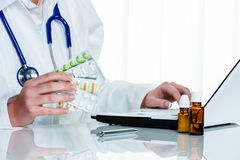 Doctor writes a prescription for tablets stock images