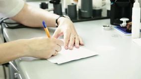 The doctor writes a prescription stock footage