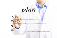 Doctor writing blank plan list. Royalty Free Stock Photo