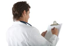 Doctor writing on a clipboard Royalty Free Stock Photo