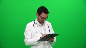 Doctor Writing On Clipboard stock video footage