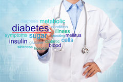 Doctor writing diabetes word. Stock Images