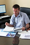 Doctor Writing On A Document Stock Image