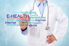 Doctor writing E-health word. Royalty Free Stock Photo