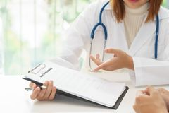 Doctor writing about her patient disease in paper, medical diagnosis concept royalty free stock photos