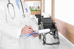 Doctor writing a medical prescription with medical background.  Stock Image