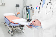 Doctor writing a medical prescription with medical background.  Royalty Free Stock Photo