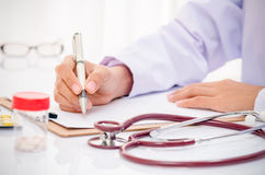 Doctor writing medical record Stock Photography