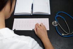Doctor writing medical records. Woman doctor writing medical records Royalty Free Stock Photography
