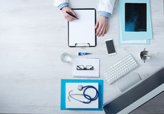 Doctor writing medical records Stock Photography