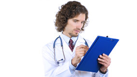 Doctor writing medical report in patient's clinical history, prescribing drugs Royalty Free Stock Images