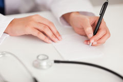 Doctor writing a note Stock Image