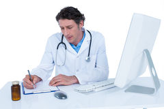 Doctor writing on a notebook Royalty Free Stock Photos