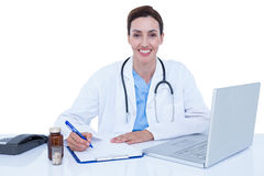 Doctor writing on a notebook Stock Image