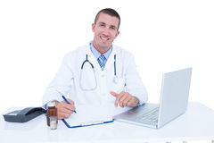 Doctor writing on a notebook Royalty Free Stock Photo
