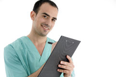 Doctor writing on notepad Stock Photo