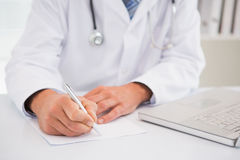 Doctor writing on a notepad Royalty Free Stock Photo