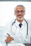 Doctor writing on notepad Royalty Free Stock Images