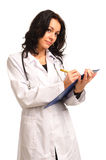 Doctor writing notes on clipboard Royalty Free Stock Photo