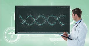 Doctor writing notes while looking at DNA structure. Digital composite of Doctor writing notes while looking at DNA structure Royalty Free Stock Image