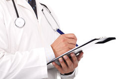 Doctor writing notes and prescriptions. Young doctor holding note books and stetoscope Stock Image