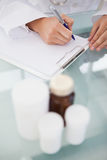 Doctor writing out prescriptions Stock Photo