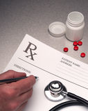 Doctor writing out RX prescription Royalty Free Stock Photography