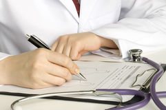 Doctor  writing on the paper Stock Photography