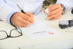 Doctor writing a perscription Stock Images