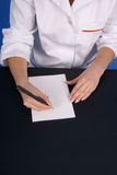 Doctor writing prescription. Stock Photo