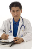 Doctor writing a prescription. Doctor and Nurse standing with white background Stock Images