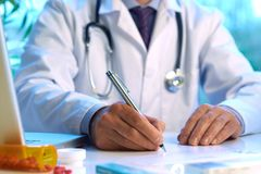 Doctor writing prescription. Selective focus Royalty Free Stock Photo