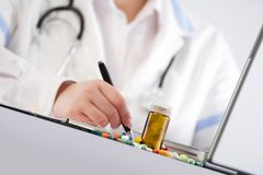 Doctor writing a prescription Royalty Free Stock Image