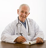 Doctor writing a prescription Stock Images