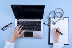 Doctor writing prescription on clipboard 1 Stock Photography
