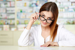 Doctor writing a prescription Stock Photography