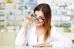 Doctor writing a prescription Stock Photography