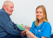 Doctor Writing Prescription For Elderly Patient Stock Photo
