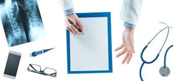 Doctor writing a prescription Stock Photos