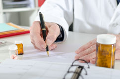 Doctor writing prescription Stock Images