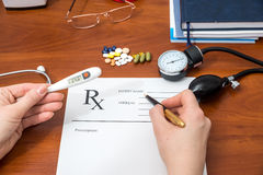 Doctor writing prescription with pills royalty free stock images