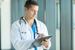 Doctor writing prescription. Professional medical doctor writing prescription Royalty Free Stock Photo