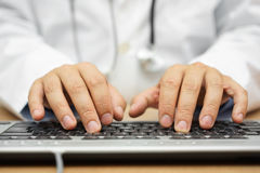 Doctor is writing report into patient folder Royalty Free Stock Photo