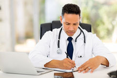 Doctor writing reports Stock Photography