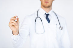 Doctor writing something in the air Stock Photography