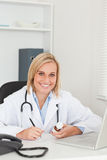 Doctor writing something down Stock Photos
