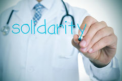 Doctor writing the word solidarity Royalty Free Stock Photo