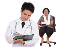Doctor writting medical report Royalty Free Stock Photography
